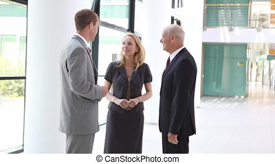 businesspeople with businessman on phone