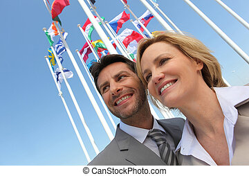 Businesspeople with flags.