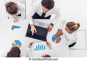 Businesspeople with reports