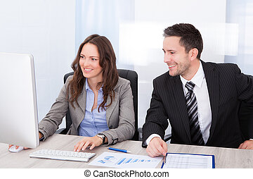 Businesspeople Working At Office