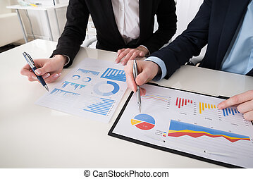 Businesspeople Working On Graph