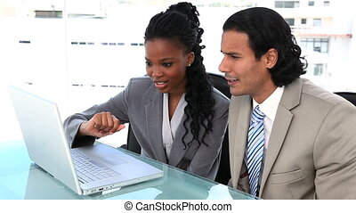 Businesspeople working with a laptop