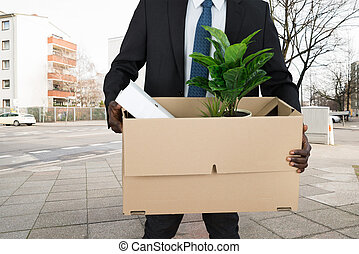 Businessperson Carrying Belongings In Cardboard Box