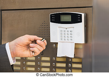 Businessperson Hand Operating Security System