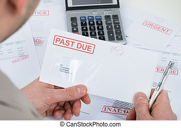 Businessperson Hand With Past Due Envelope