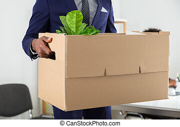 Businessperson Holding Belongings In Cardboard Box