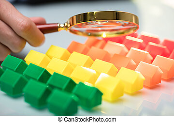 Businessperson Holding Magnifying Glass