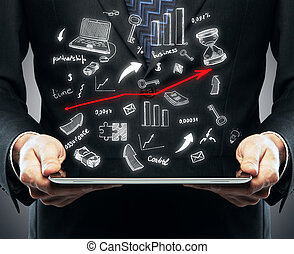 Online business concept - Businessperson holding tablet with...