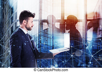 Businessperson in office connected on internet network with a laptop. concept of partnership and teamwork