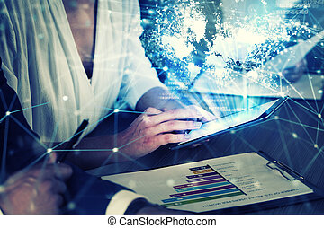 Businessperson in office connected on internet network with tablet. concept of partnership and teamwork
