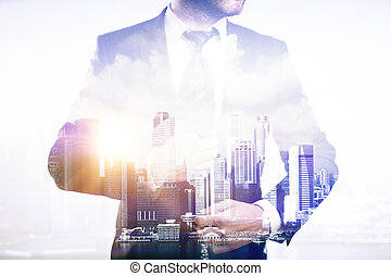 Businessperson on city background. Double exposure