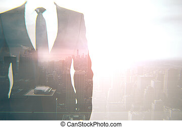 Businessperson on city background multiexposure