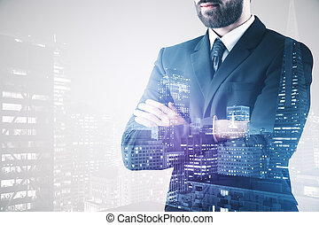 Businessperson on city background