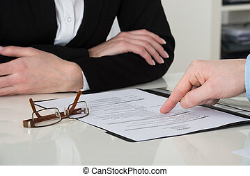 Businessperson Pointing On Document
