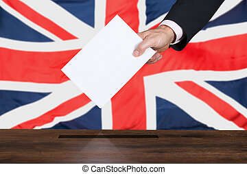 Businessperson Putting Vote Into Ballot Box