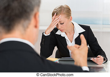 Businessperson Quarreling To Businesswoman - Close-up Of...