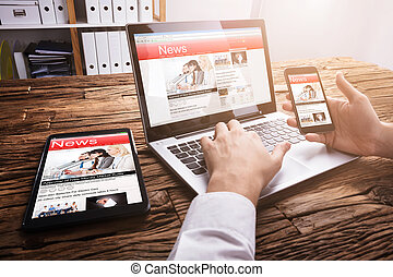 Businessperson Reading Online News On Laptop