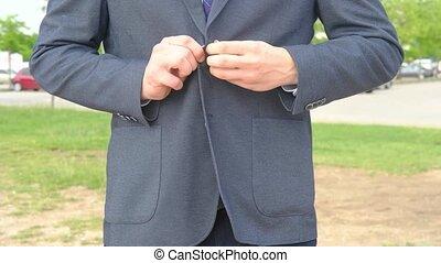 Businessperson straightening jacket