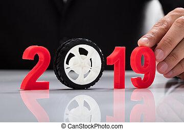 Businessperson touching 2019 year