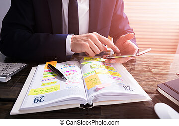 Businessperson Using Mobile Phone