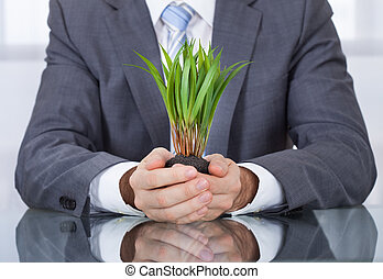 Businessperson With Green Grass