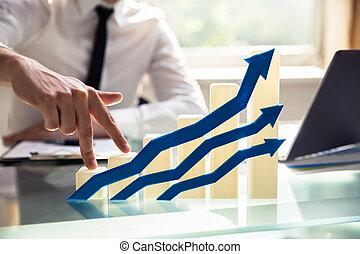 Businessperson's Finger Climbing Increasing Graph