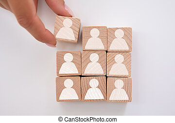Businessperson's Hand Holding Cubic Block