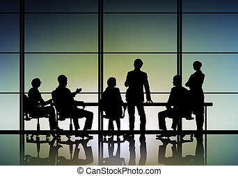 Businessteam at work - Silhouttes of business people as team...