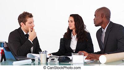 Businessteam conversing about a new plan - Businessteam...