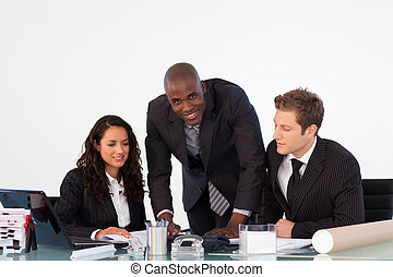 Businessteam discussing a new plan - Business team ...