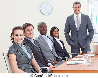 Businessteam in a meeting analyzing profits and taxes -...