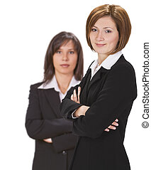 Businessteam - Two confident businesswomen against a white...