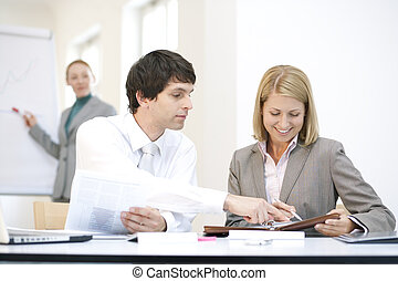Businessteam, three businesspeople in a meeting - discussion