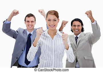 Businessteam with arms raised against a white background