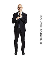 Businesswear - Studio shot of young man getting ready...