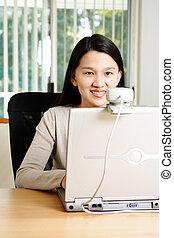 Businesswoman - A businesswoman using webcam to communicate