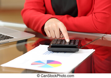 Businesswoman accounting with calculator
