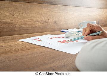 Businesswoman analysing a bar graph