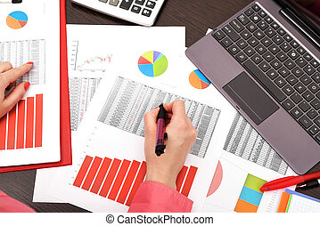 businesswoman analyzing investment charts