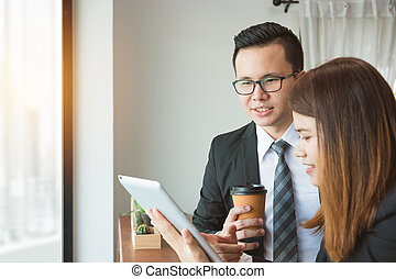 Businesswoman and businessman discussion about work at office