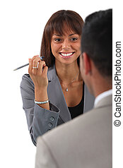 businesswoman and businessman having a discussion