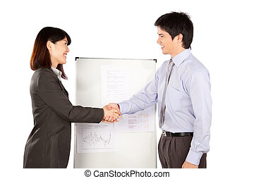 Businesswoman and Businessman Shaking Hand