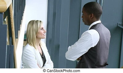 Businesswoman and  businessman talking
