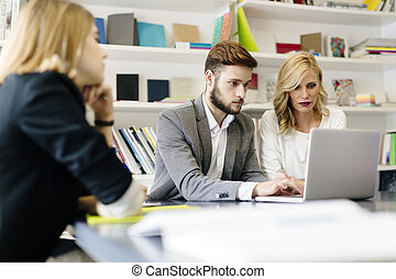 Businesswoman and businessman working in office