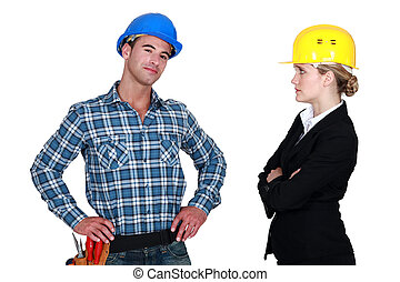 businesswoman and craftsman posing together