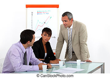 businesswoman and male colleagues at meeting