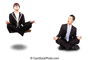 businesswoman and businessman in yoga lotus-pose and relaxing. Surprised man watching woman Floating in the air