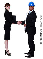 businesswoman and real estate businessman shaking hands