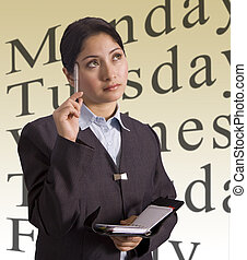 Businesswoman and schedule - A young businesswoman thinking...