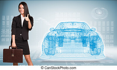 Businesswoman and wire-frame car - Businesswoman holding...